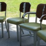 1950's chairs with impala skin backs and olive leather seats